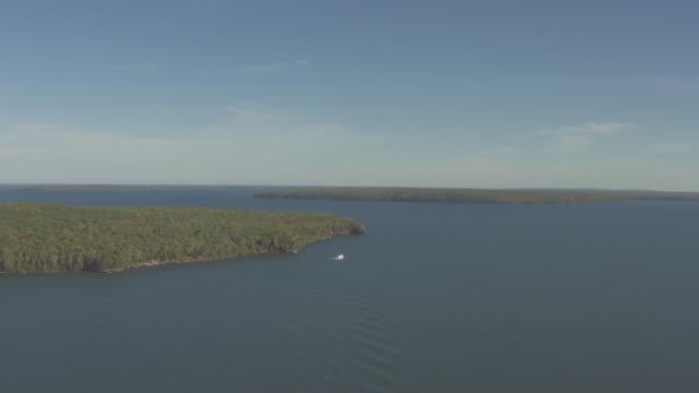 ws aerial view of superior princess boat near hermit island in lake superior / wisconsin, united states  - lago superiore video stock e b–roll