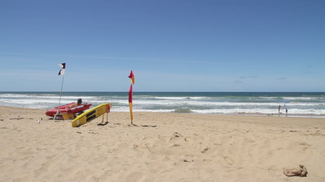 ms pan view of surf rescue boards and dune buggy  / melbourne, victoria, australia - dune buggy stock videos and b-roll footage