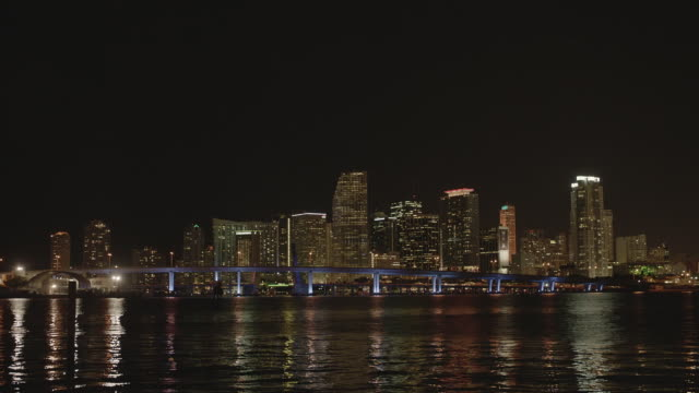 ws pan view of suspended freeway on water with miami apartments at night / miami, florida, united states - 2k resolution stock videos and b-roll footage