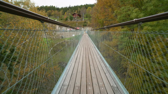 view of suspension bridge in switzerland. - suspension bridge stock videos & royalty-free footage