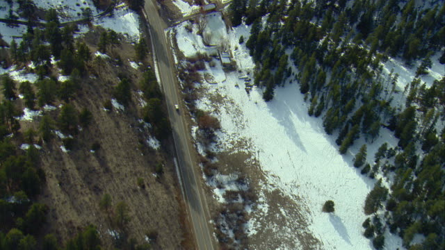 WS TS AERIAL View of SUV driving on two-lane highway near Pike National Forest outside Denver / Denver, Colorado, USA