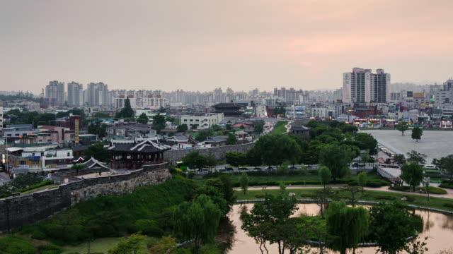 ws t/l view of suwon hwaseong castle area behind sunwon city / suwon, gyeonggi do, south korea  - hwaseong palace stock videos and b-roll footage