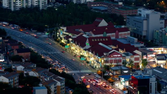 view of suwon premium outlet and traffic moving at night - suwon stock videos and b-roll footage