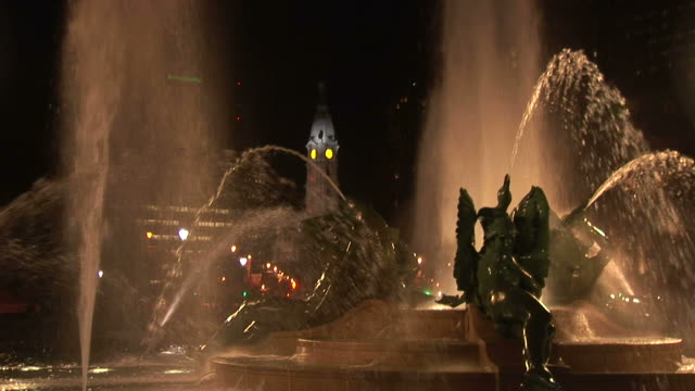view of swann memorial fountain and city hall clock tower at night in philadelphia united states - swann memorial fountain stock videos & royalty-free footage