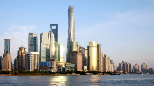 view of swfc tower and skyscrapers on the huangpu river at daytime in shanghai, china - ausflugsboot stock-videos und b-roll-filmmaterial