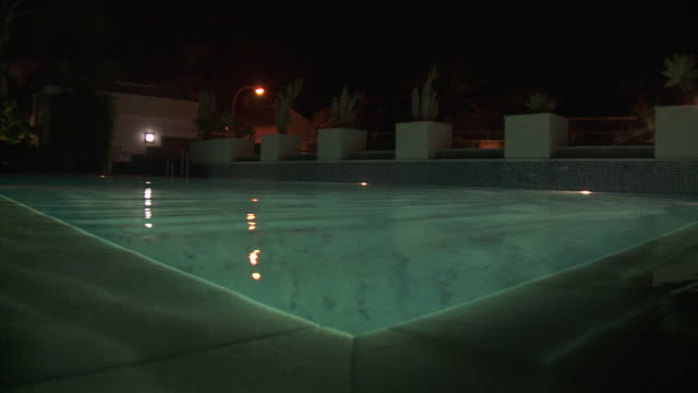 MS View of Swimming Pool at night / Marbella, Andalusia, Spain