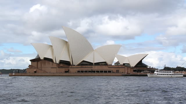 WS View of  Sydney Opera house with moving boats / Sydney, Australia