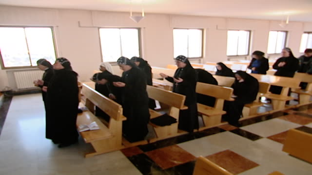 view of syriac orthodox nuns during mass in the church seminary of st ephrem the syrian in saidnaya. - nun stock videos & royalty-free footage