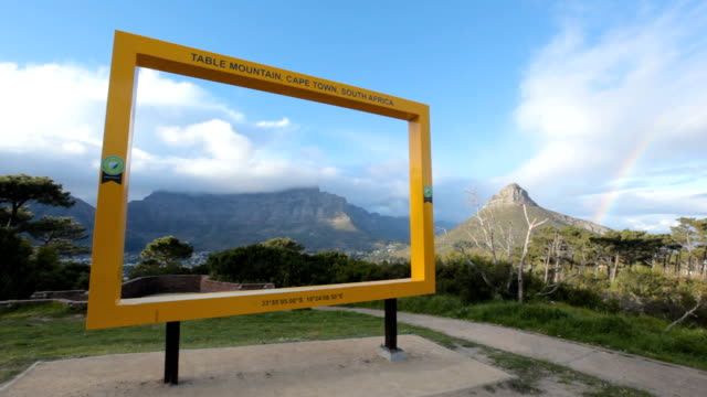 PAN View of Table Mountain through 7 Wonders of the World frame, Cape Town, South Africa