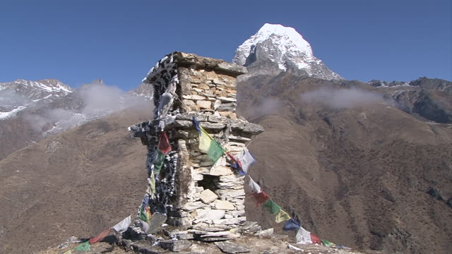 ms zo view of taboche peak with chorten and prayer flag / pangboche khumbu region nepal - khumbu stock videos & royalty-free footage