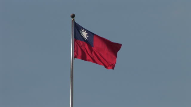 view of taiwan national flag flapping in taipei taiwan - taiwanese flag stock videos & royalty-free footage