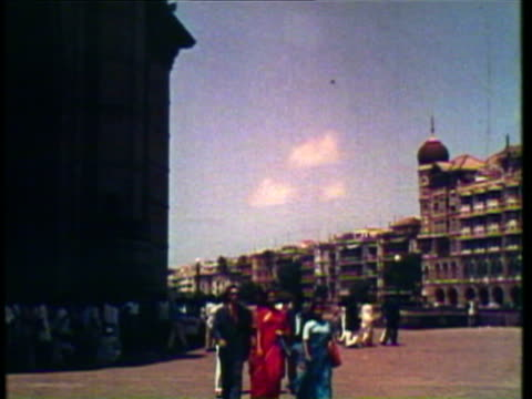 1953 ws pan view of taj mahal, men riding bikes along wide street / agra, new dehli, india / audio - agra stock videos and b-roll footage