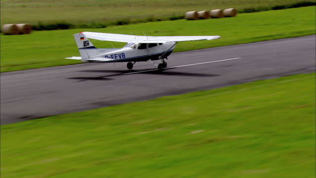 AERIAL MS TS View of takeoff small airplane / Wangerooge, Lower Saxony, Germany