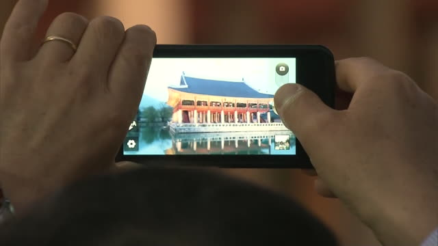 View of taking photograph of Gyeonghoeru pavilion(Korea National Treasure 224) and the Pond in Gyeongbokgung(Royal palace of the Joseon dynasty) by Cell phone