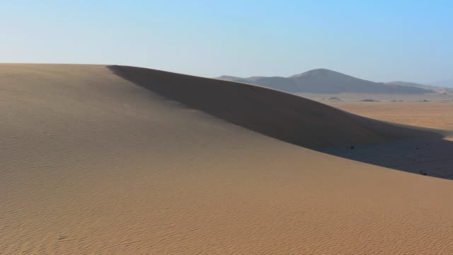 WS View of tall wonderful sand dunes of Hartmann Berge deserted land Hartmann Valley Marie flub with hills and ripples / Namib Desert, Namibia, South Africa