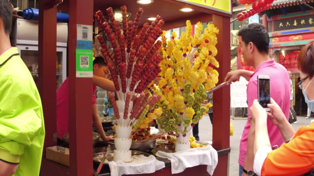 A view of Tanghulu in famous Wangfujing Snack Street on May 4 2017 in Beijing China Wangfujing is a main business street for tourism next to the...
