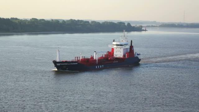 ws view of tanker on elbe river / gluckstadt, schleswig holstein, germany - schleswig holstein stock-videos und b-roll-filmmaterial
