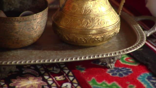 cu tu view of tea pot / muscat, oman - tea pot stock videos and b-roll footage