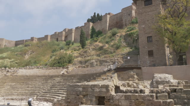 vidéos et rushes de view of teatro romano and alcazaba, malaga, andalucia, spain, europe - xième siècle