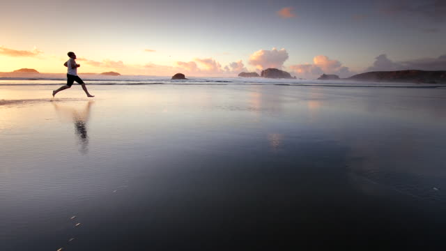 ws slo mo pov ts view of teen boy running on beach / bandon, oregon, united states - teenagers only stock videos and b-roll footage