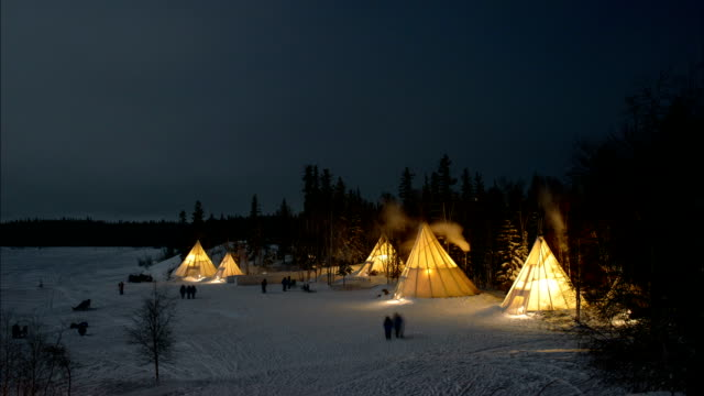 View of Teepees and skyscape above Aurora Village