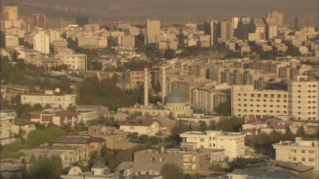 ws ha view of tehran with blue domed mosque at sunset / iran - tehran stock videos and b-roll footage