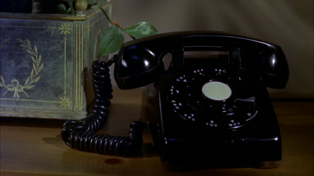 cu view of telephone on desk - rotary phone stock videos and b-roll footage
