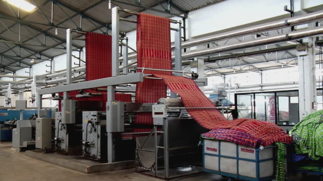 ws view of textile machine, kanakaria textile mills / ahemdabad, gujarat, india - 織物工場点の映像素材/bロール