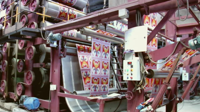 ms view of textile machine, mangal textile mill / ahemdabad, gujarat, india - 織物工場点の映像素材/bロール