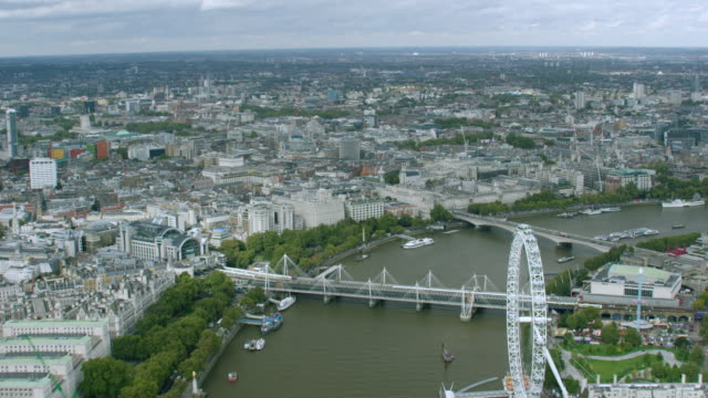 ws aerial pov view of thames river and cityscape / london, england, united kingdom - millennium wheel stock videos and b-roll footage