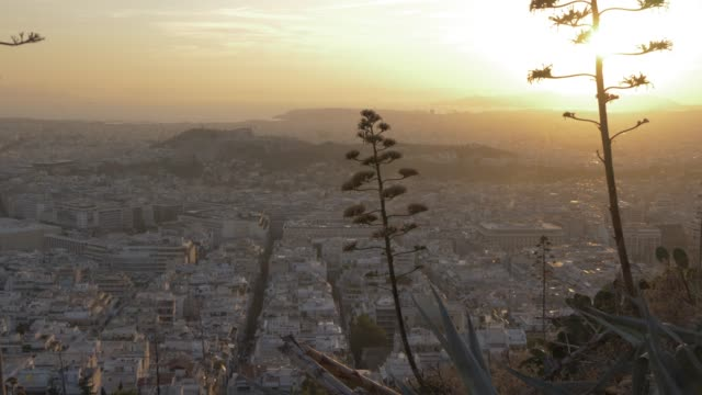 view of the acropolis and athens from the path on mount lycabettus at sunset, athens, greece, europe - lycabettus hill stock videos & royalty-free footage