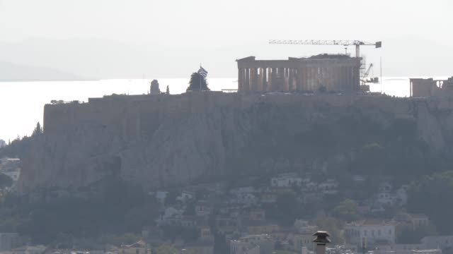 view of the acropolis, unesco world heritage site, from mount lycabettus, athens, greece, europe - old ruin stock videos & royalty-free footage