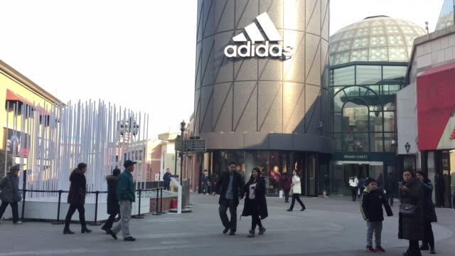 view of the adidas store in solana shopping mall on feb 12, 2017 in beijing, china. - adidas stock videos & royalty-free footage