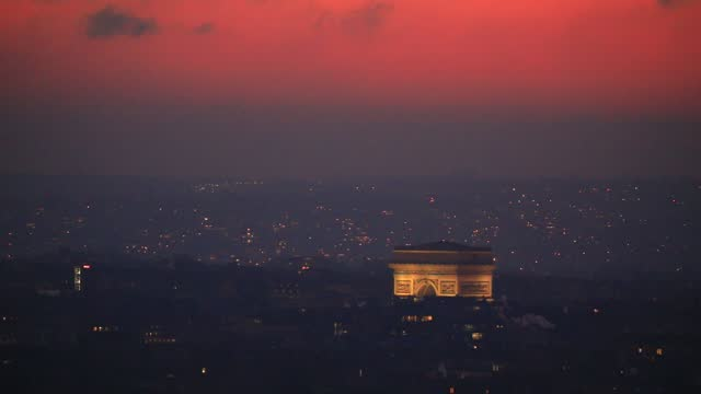 view of the arc de triomphe in the background a sky filled with the colour pink at dusk on january 9 in paris, france. france advances, on saturday,... - triumphal arch stock videos & royalty-free footage
