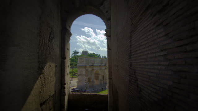 view of the arch of constantine framed by a window in the colosseum - arch of constantine stock videos and b-roll footage