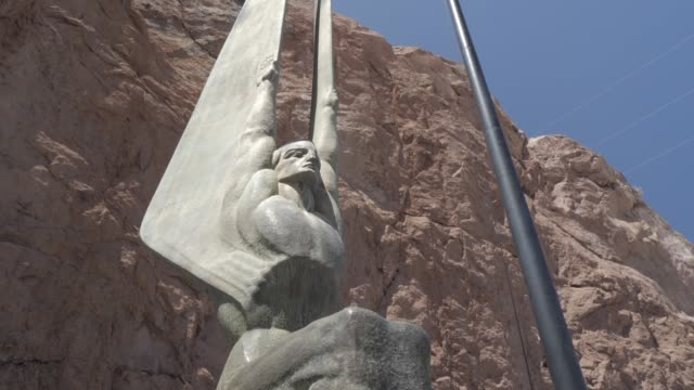 view of the art nouveau statue monuments at the hoover dam, nevada/arizona border, united states of america, north america - male likeness stock videos & royalty-free footage