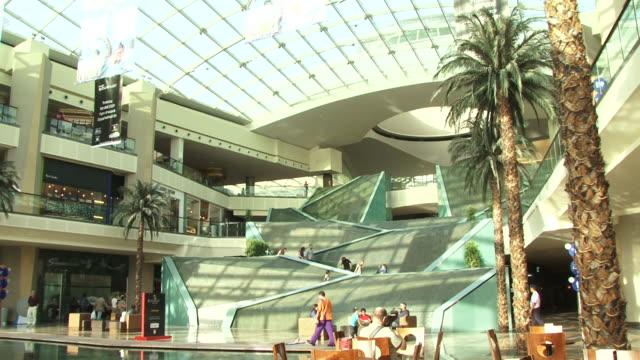 view of the atrium and architectural water feature staircase at dubai festival city mall. - maskinskriven text bildbanksvideor och videomaterial från bakom kulisserna