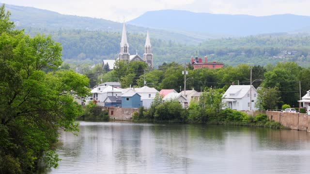 view of the baie-saint-paul village on a cloudy summer afternoon - rural scene stock videos & royalty-free footage