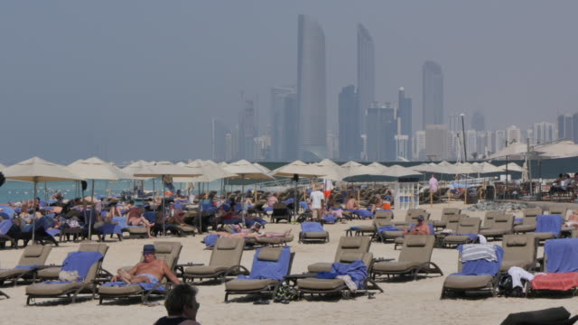 view of the beach on the corniche, abu dhabi, united arab emirates, middle east, asia - middle eastern stock videos and b-roll footage