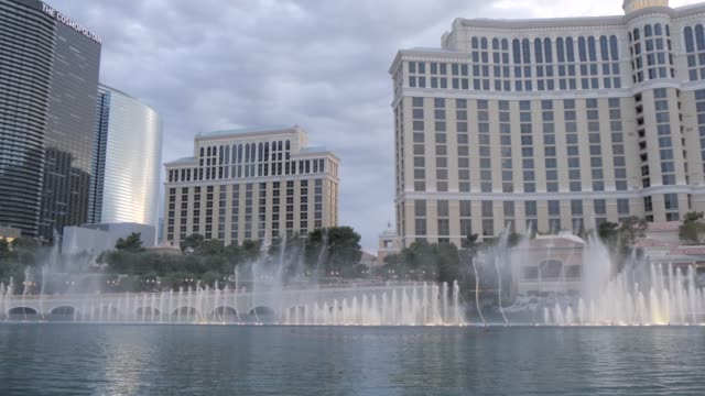 view of the bellagio hotel and casino fountains at dusk on the strip, las vegas boulevard, las vegas, nevada, united states of america, north america - fountain stock videos & royalty-free footage
