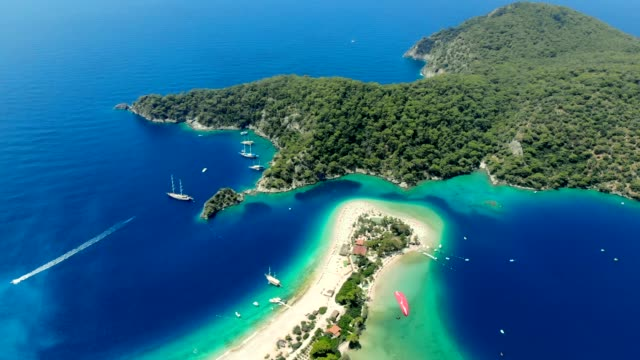 view of the blue lagoon, oludeniz, mugla, turkey - paragliding stock videos & royalty-free footage