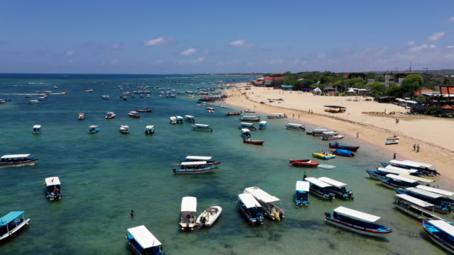 view of the boats floating near the beach in bali, indonesia - indonesia travel stock videos & royalty-free footage