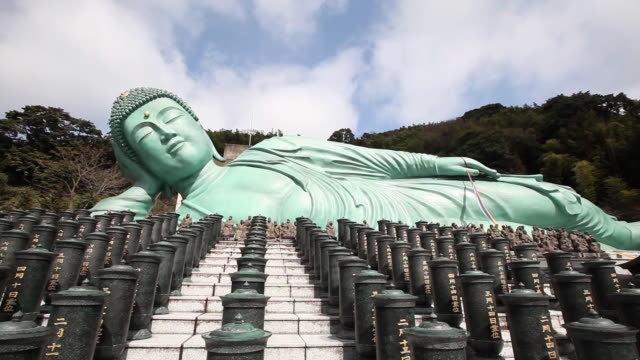 view of the buddha statue in nanzoin temple, fukuoka, kyushu - statue stock videos & royalty-free footage