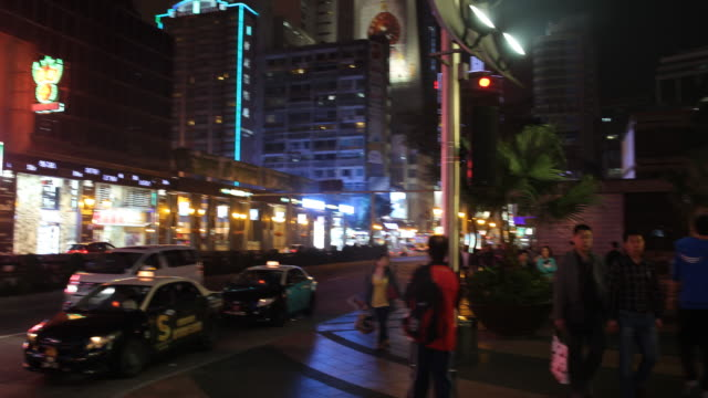 a view of the busy night at avenida de lisboa in macau tourism and gambling are the primary drivers of macau's economy - avenida stock videos & royalty-free footage