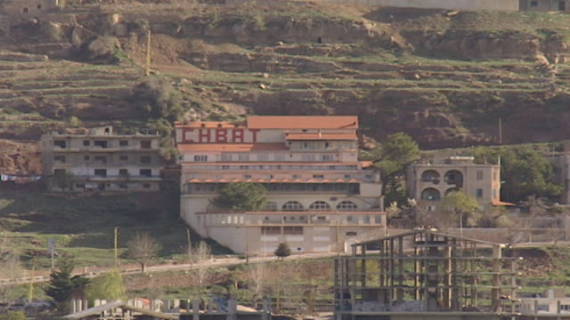 view of the chbat hotel located in the village of bsharri overlooling the qadisha gorge - snowcapped mountain stock videos & royalty-free footage