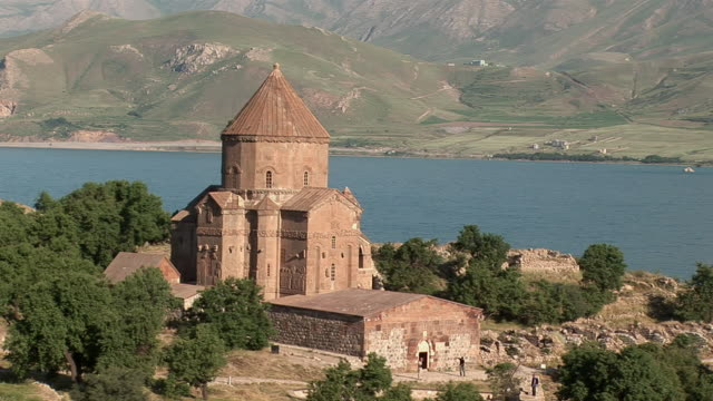 ms view of the church in front of lake / lake van, van district, turkey - lake van stock videos and b-roll footage