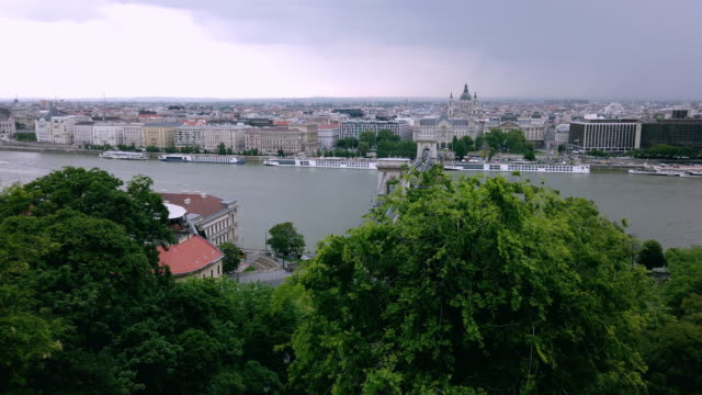 view of the city landscape on the other side of the river - széchenyi chain bridge stock videos & royalty-free footage