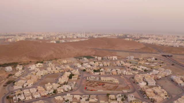 aerial view of the city of muscat - tourist stock videos & royalty-free footage