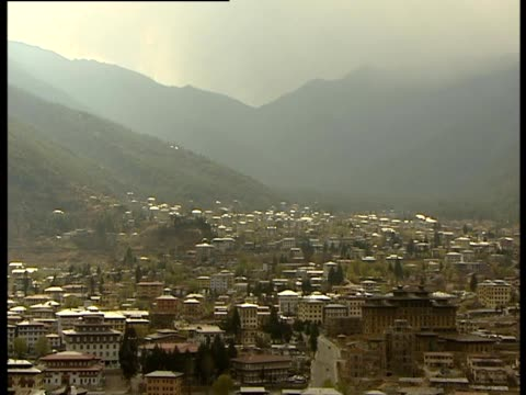 a view of the city of thimphu in bhutan - thimphu stock videos & royalty-free footage