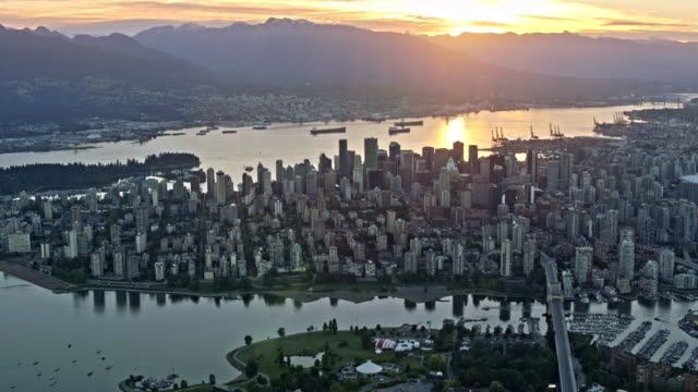 aerial view of the city of vancouver and false creek at sunset - vancouver canada stock videos & royalty-free footage